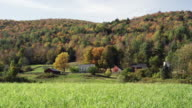 Vermont farm in the autumn with grass and trees
