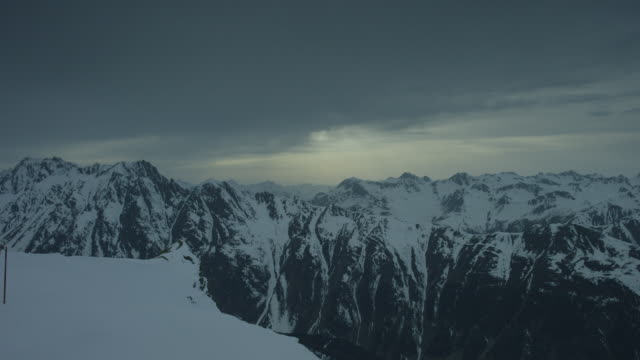 A very slow pan over a mystic snow covered mountain scenery.