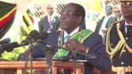 Veteran Zimbabwean President Robert Mugabe hit out at vile Western critics as he was sworn in for another five year term Thursday in a stadium packed...