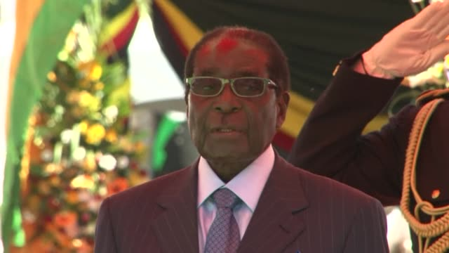 Veteran Zimbabwean President Robert Mugabe hit out at Western critics as he was sworn in for another five year term Thursday in a stadium packed with...