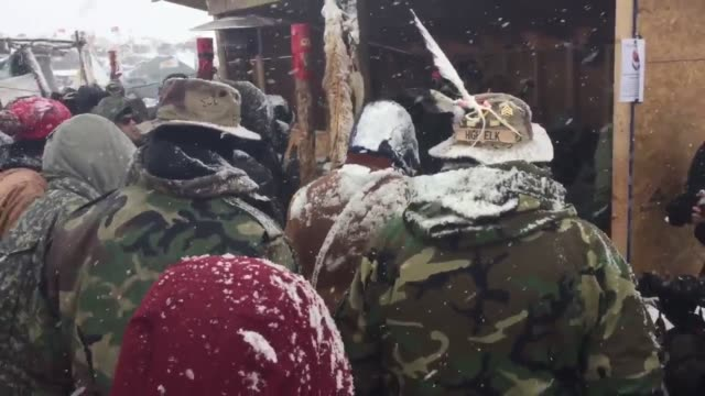 Veterans from across the country form a human barrier north of the Oceti Sakowin camp standing in solidarity with the antiDAPL movement Native...