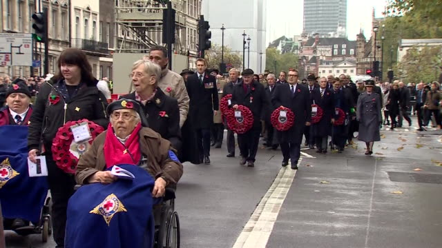 Veterans of WWII and other conflicts observing two minutes silence on Armistice Day
