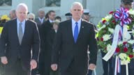 US Vice President elect Mike Pence and Senator John McCain remember 75 years since the Japanese attack of Pearl Harbor at the National World War II...