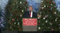 US vice president elect Mike Pence introduces presidentelect Donald Trump thank you speech in Orlando Florida many christmas trees as backdrop