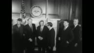 Vice President Hubert Humphrey greets freshman senators as they arrive for the 90th Congress / senators stand with Vice President for a photo op / CU...
