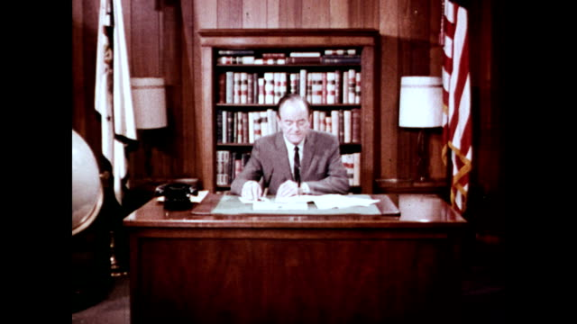 / Vice President Hubert Humphrey meets with a Mr Marshall in his office to discuss Medicare / secretary takes man's hat from him / men get ready to...