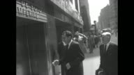 Vice President Richard Nixon and American Legion comander James F O'Neil on street then entering Chrysler Building / Nixon O'Neil and view of Art...