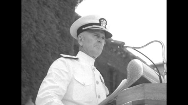 ViceAdm Harry Hill on left and Adm C Turner Joy on right coming down steps of building midshipmen standing in formation on steps Hill and Joy come to...