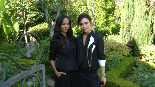Victoria Beckham and Zoe Saldana at the Victoria Beckham For Target Launch Event on April 1 2017 in Los Angeles California