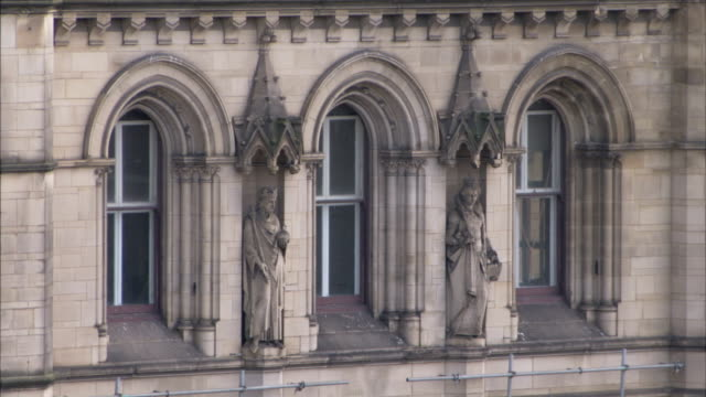 Victorian arches decorate the facade of the Manchester Town Hall in England. Available in HD.