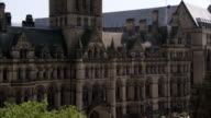 A Victorian clock tower tops the Manchester City Hall in England. Available in HD.
