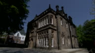 A Victorian house features ornate decorative stone carving. Available in HD.
