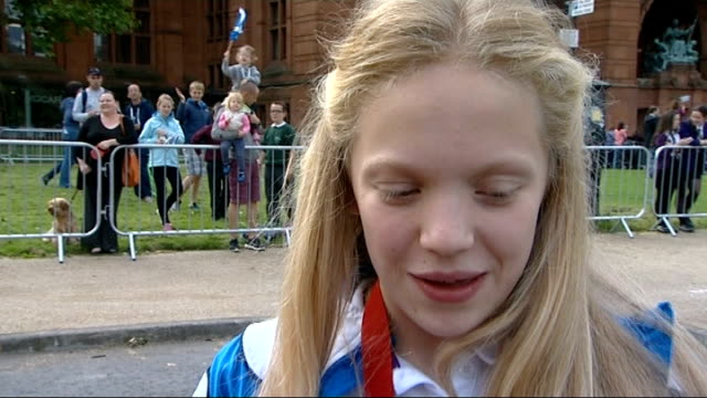 Victory parade for Scottish athletes Erraid Davies interview SOT Various of Davies and other athletes boarding decorated lorries ready for parade...