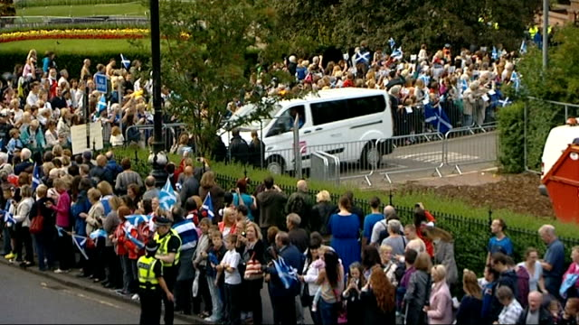 Victory parade for Scottish athletes Various of athletes being paraded through the city in decorated lorries led by a pipe band as crowds cheer and...