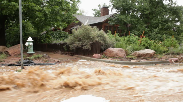 HD video Boulder flood waters past home