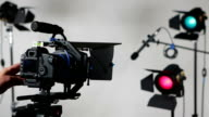 DSLR video camera slider with studio lights
