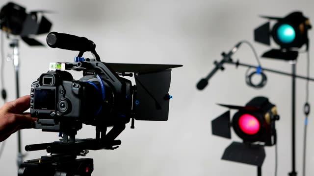 DSLR video camera slider with studio lights