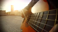 POV video: close-up man playing guitar