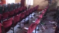 Video displays scenes from the site where a bomber blew himself up inside a cultural center in the Ibb city of Yemen as the members of Shiite...