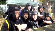 Video footage shows about 100 stealthy ninja warriorsor revelers dressed the partsneaking their way through central Tokyo on December 4 tokyo Japan...