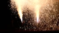 "Video footage taken at Yoshidajinja shrine in Toyohashi Aichi Prefecture shows men dressed in ""happi"" coats holding and launching gushing fireworks..."