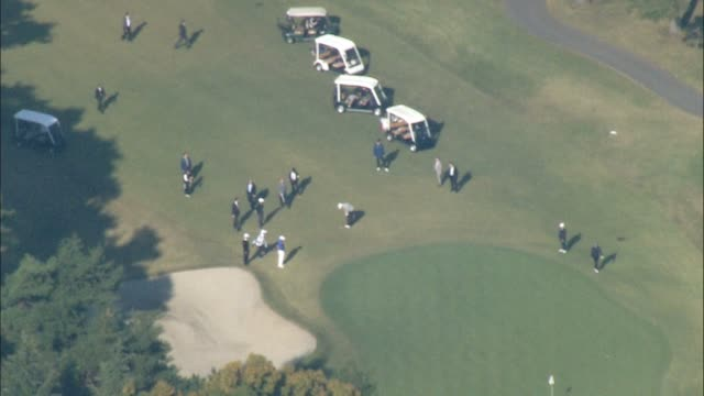 Video footage taken from a helicopter hovering above a golf course in Kawagoe Saitama Prefecture shows US President Donald Trump and Japan's Prime...