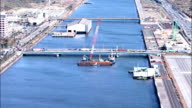 Video footage taken from a helicopter on December 8 Japan shows construction on Tokyo Bay as a barge lays the first piles at the Sea Forest Waterway...