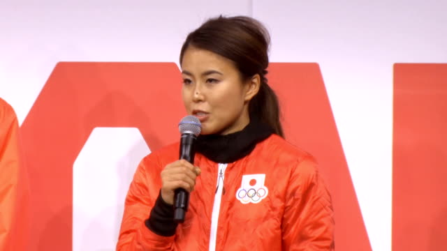 """Video footage taken in Tokyo on Nov 1 shows a group of Japanese athletes modelling the vibrant """"sunrise red"""" outerwear the Japanese contingent will..."""