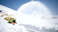 Video footage taken on April 6Japan in the Shiretoko mountain range of Hokkaido shows workers removing snow to clear a closed section of popular...