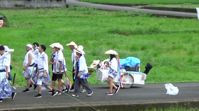 "Video footage taken on Aug 26 in Nakatsu Oita Prefecture shows carts bearing ornate flowerfestooned ""hanakasaboko"" umbrella domes being pulled..."