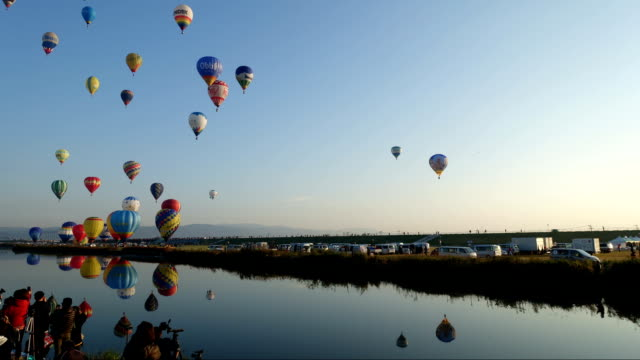 Video footage taken on Nov 1 in Saga city shows dozens of manned hotair balloons taking off one by one from a ground beside the Kasegawa river and...