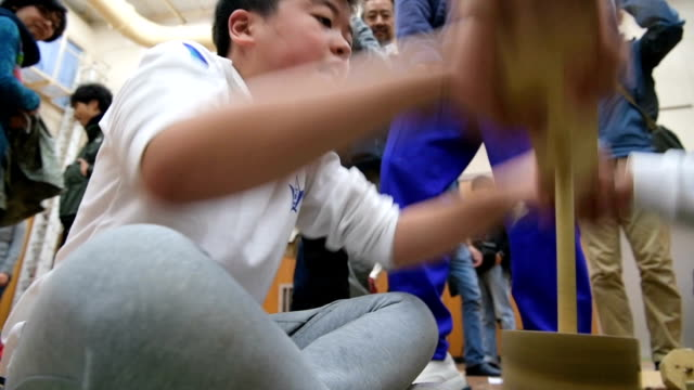 Video footage taken on Nov 9 at a chilly Kobe municipal primary school near the top of Mount Rokko shows students heatedly spinning wooden sticks to...