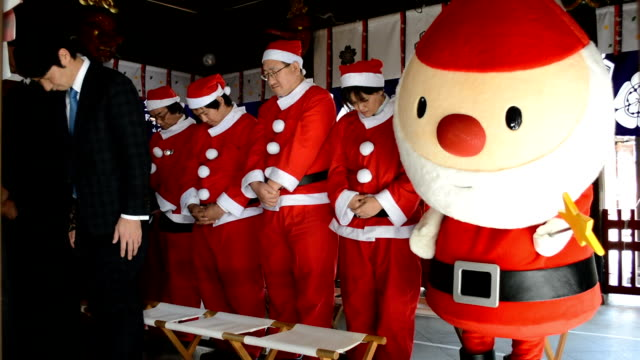 Video footage taken on Novemer 21Japan at Kushidajinja shrine in Fukuoka shows a group of taxi drivers clad as Santa Claus together with a Santa...