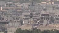 A video footaged from Suruc district of Turkey's Sanliurfa province shows a group of Syrians wait at Syrian side of Turkish border during the clashes...