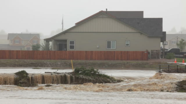 HD video Frederick flood waters flow past homes Colorado