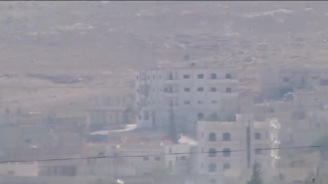 A video from Suruc district of Sanliurfa shows an Islamic State of Iraq and the Levant flag on the roof of a building and on the hill in the Syrian...