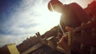 POV video: man playing guitar on the terrace