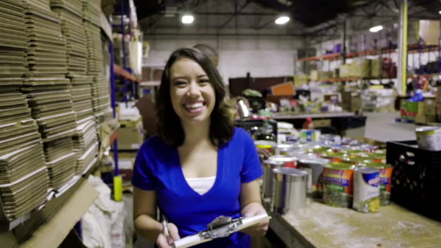 Video montage of volunteers helping people in need with charitable donations