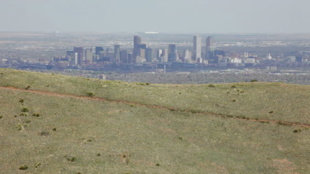HD video mountain biker and downtown Denver Colorado