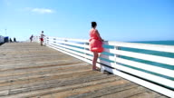 Video of a woman at the pier in California-slow motion