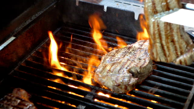 Video of cooking steaks on the fire-real slow motion