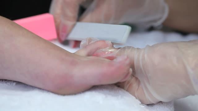 Video of cosmetician polishing toenails