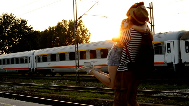 Video of couple hugging on train station