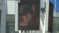 Video of Michael Jackson images on large screens outside the Staples Center before Memorial Service/ Los Angeles California USA