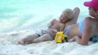 video of mother and son playing at the Caribbean beach