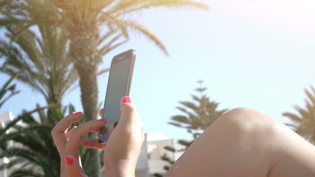 Video of woman using mobile phone in 4K
