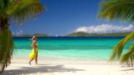 video of woman walking along the Caribbean beach shoreline