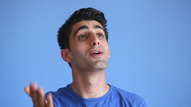 Video Of Young Man Enjoying On Blue Background