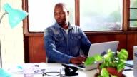Video portrait African businessman creative studio office