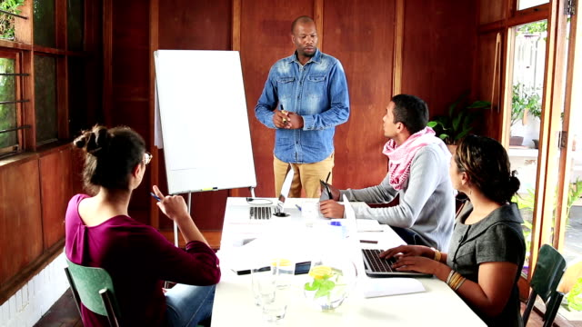 Video portrait African businessman leads creative team